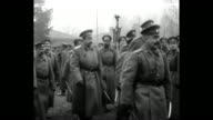 Czar Nicholas II and officers review Russian troops / Czar Archbishop of Poland and officers walking / WS Czar and Grand Duke Nicholas walking in...