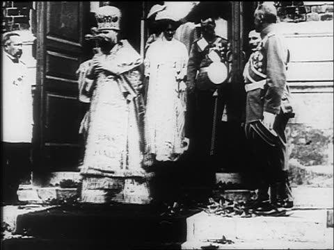 Czar Nicholas II of Russia family coming down steps of church / documentary