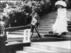 Czar Nicholas II of Russia family descending stairs as officers salute / documentary