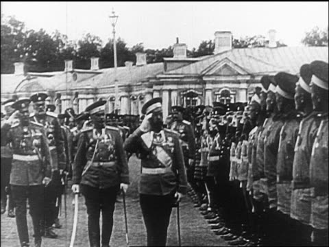 Czar Nicholas II saluting as he inspects army troops / documentary