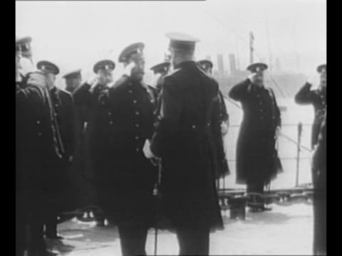 Czar Nicholas II steps onto Russian battleship salutes officers during fleet inspection during World War I / Nicholas conducts military review of...