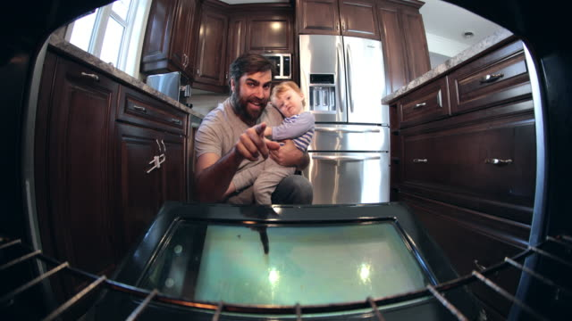 POV 4K Dad and Baby Looking Inside Oven