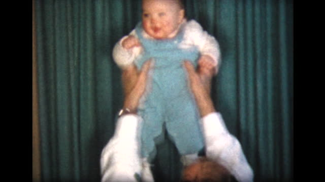 1957 dad tosses around 10 month old daughter