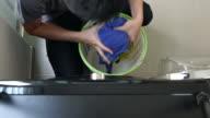 Daily chores: Man laundry at home
