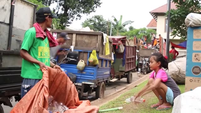 Daily life of Indonesian Siti Fatimah a girl who was born and has been raised in a family of scavengers in Jakarta Indonesia Jakartabased Siti...