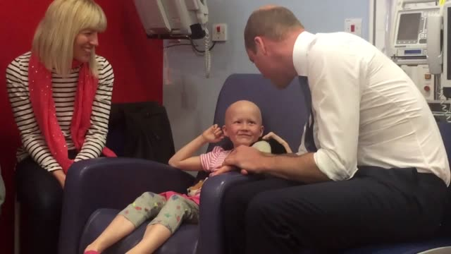 Daisy Wood six was happy to let the future king strap a cuff to her arm in preparation for the reading when he visited the children's cancer unit at...