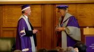 Dalai Lama receives honorary doctorate from London Metropolitan University University official awarding Dalai Lama with honorary degree of Doctor of...