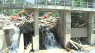 Dam blocked with trees after major landslides, zoom out