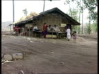 Dam protests River Narmada Sardar Sarovar Dam Gujerat / Maharashtra Manibeli MS Ox standing in field as monsoon rains fall MS Children standing...