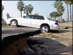 / damage from the Northridge earthquake / mudslide damage houses and cars buried in Pacific Palisades / damaged parking lot in Redondo Beach / broken...