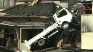 Damage in port area of Kesennuma City, Japan filmed on 1 April 2011, 3 weeks after a tsunami which was caused by magnitude 9 Tohoku earthquake off north east Japan / AUDIO