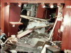 Damaged bus and internal shots of wrecked public house following bomb attack 21 November 1974