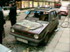 Damaged cars line the street following the IRA car bomb attack outside Harrods 1983