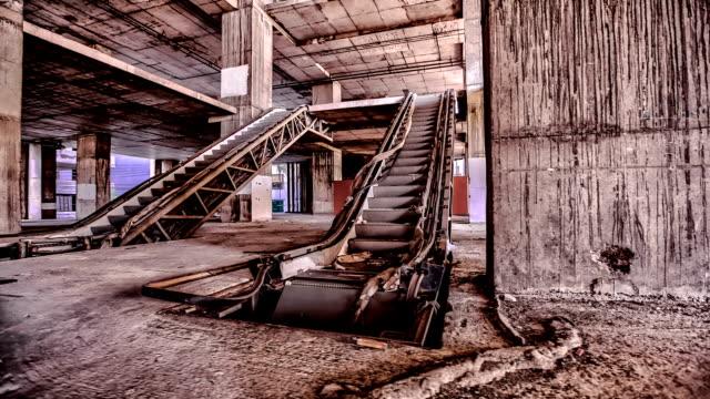 Damaged escalator inside abandoned building