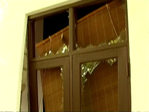 CU damaged windows of house with glass smashed, tsunami aftermath, Maldives