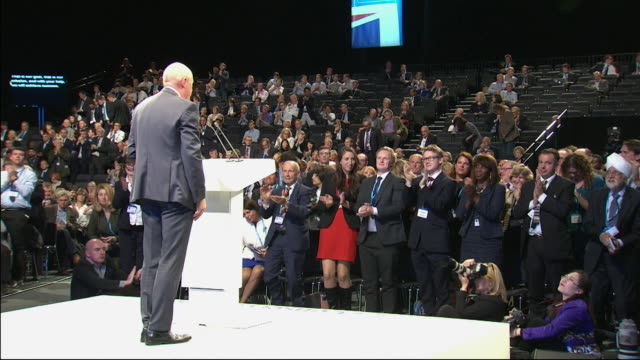 Damian Green tripping as he exits the stage at the Conservative Party conference