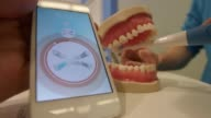 Damien Seux from Kolibree talks us through an interactive toothbrush with artificial intelligence on display at the Mobile World Congress in Barcelona