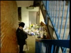 two defendants found not guilty FILE / T04120001 Peckham Floral tributes in stairwell where Damilola died with police officer on duty beside FILE /...