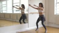 Dancer warming-up in dance studio