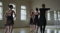 dancers in a dance studio with instructor