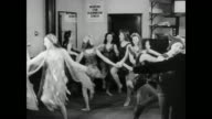 HA Dancers in costume rehearsing in small theater for pantomime / England, United Kingdom
