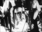 B/W 1928 MONTAGE dancers, musicians + musical instruments in nightclub act / newsreel