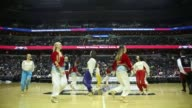 Dancers with the Kardelen Turkish Dance Ensemble perform during halftime of the Washington Wizards and New Orleans Pelicans game for Turkish Heritage...