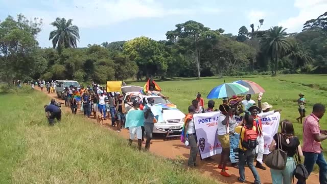 Dancing and waving rainbow coloured flags Ugandan activists held their first gay pride rally Saturday since the overturning of a tough anti...