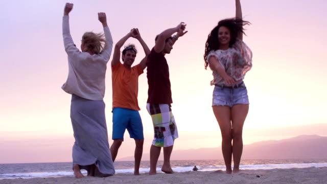 dancing beach friends slow motion stock footage video