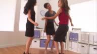 Dancing businesswomen