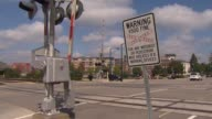 'Danger' and 'Warning' signs at a railroad tracks crossing in Chicago