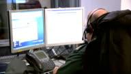 Dangerous pollution levels across Britain GVs Ambulance call centre ENGLAND London INT Various of staff in Ambulance call centre seated at computers...