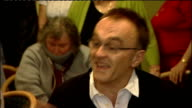 Danny Boyle returns to Radcliffe social club after winning Oscar Danny Boyle press conference continued SOT large sum of money to be distributed to...