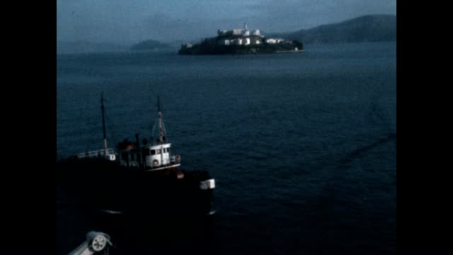 E Dant Commercial shipping vessel arriving in San Francisco harbor and assisted by Sea King Tug Boat