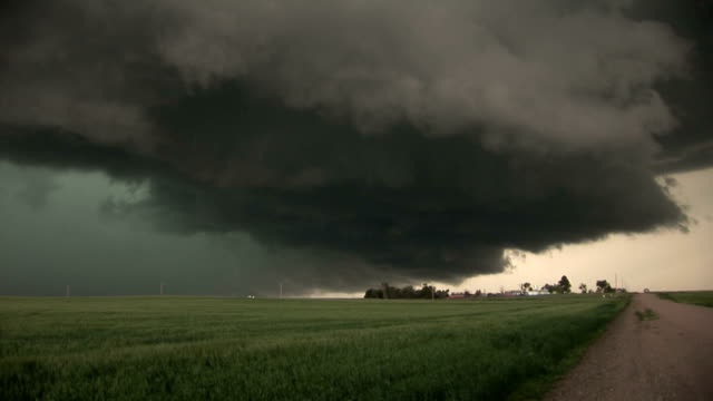 Dark and ominous storm clouds from a supercell thunderstorm hover over the ground near Dalton NE