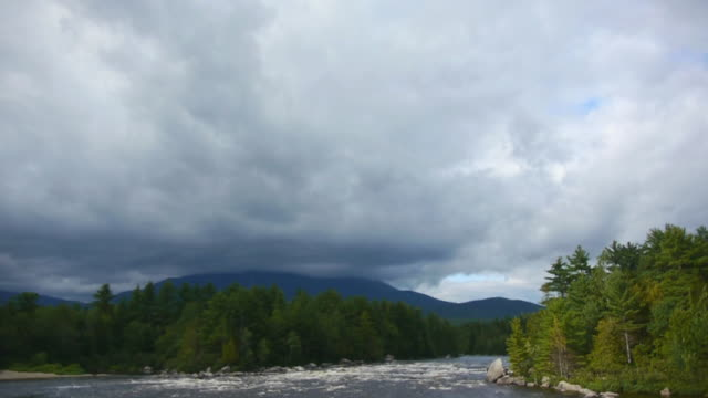 T/L Dark clouds enshroud Mt. Katahdin, Abol Falls on West Branch of the Penobscot River, Baxter State Park, Maine Woods