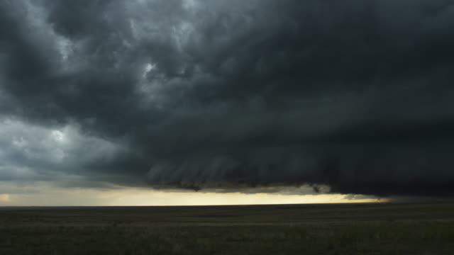 Darkening shelf cloud over prairie landscape, time lapse