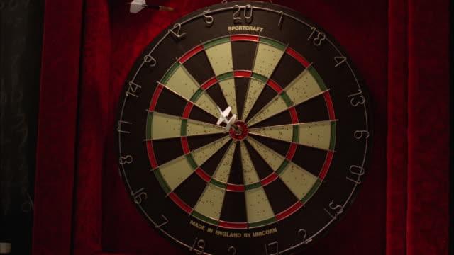 MS Darts hit wall near bull's eye at dart board