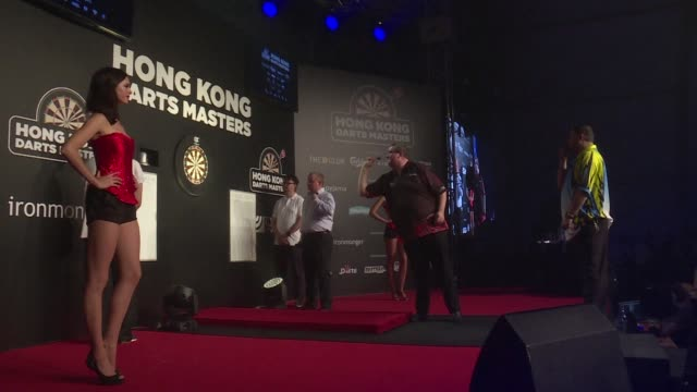 Darts stars compete in the Hong Kong Masters where raucous fans and a party atmosphere prevail as the sport looks to make an impact in Asia