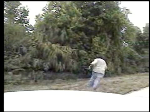 / dashcam video of police chasing carjacking suspect / wild man with weapons in both hands running away from police across highway / when man refuses...