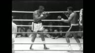 Dave Bailey and Sonny Liston meet at boxing match in Sweden / men fight before Swedish audience / Liston puts Bailey on the ground with a punch /...