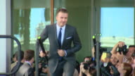 David Beckham taking the stage at the launch event for his new MLS football team in Miami Florida