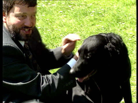 David Blunketts new guide dog ENGLAND David Blunkett with new black labrador/retriever cross guide dog 'Lucy' CMS Lucy TBV Press taking pix of...