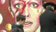 David Bowie fans who gathered to remember the rock star at a mural of him near his London birthplace on Monday credited him with inspiring everyone...