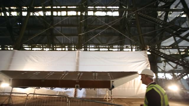 David Burns the test pilot for Hybrid Air Vehicles admires the heliumfilled 'Airlander' aircraft in a giant airship shed on February 28 2014 in...