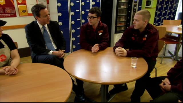 David Cameron and Iain Duncan Smith visit Sainsbury's supermarket Cameron along with Sainbury's staff and through doors / various of Cameron and Iain...