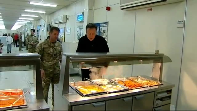 David Cameron and Michael Owen visit Camp Bastion AFGHANISTAN Helmand Province Camp Bastion INT David Cameron MP along in canteen with Michael Owen...