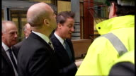 David Cameron and Swedish Prime Minister visit the Royal London Hospital EXT Hospital buildings / Cameron and Reinfeldt greeting sit worker as along...