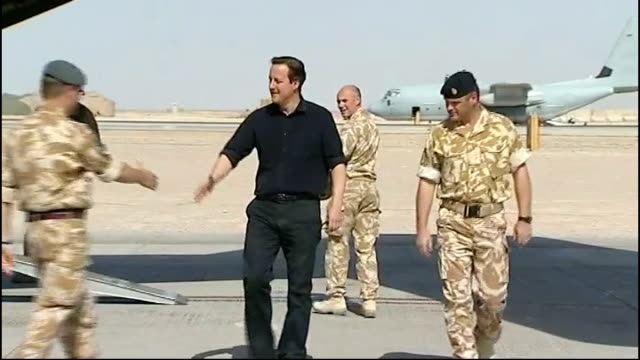 David Cameron honours pledge to support combat veterans' charity AFGHANISTAN Camp Bastion David Cameron MP greeting British army officer then along...