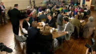 David Cameron in Bedford and making speech ENGLAND Bedfordshire Bedford INT David Cameron MP chatting to local people around tables about Bedford SOT...